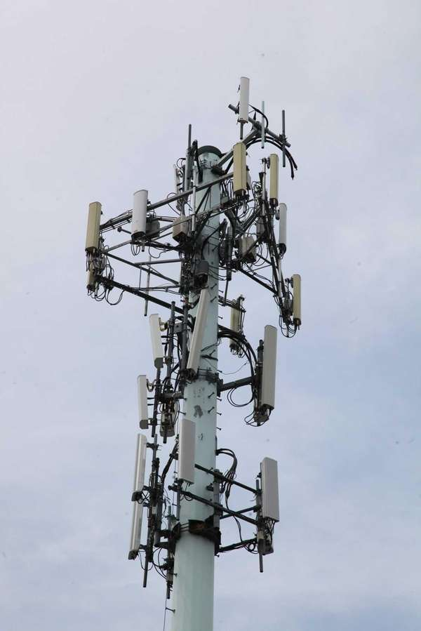 A cell tower is situated next to the