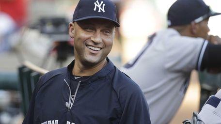 Yankees shortstop Derek Jeter laughs while standing in
