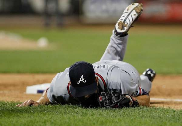 Atlanta Braves pitcher Tim Hudson lays on the