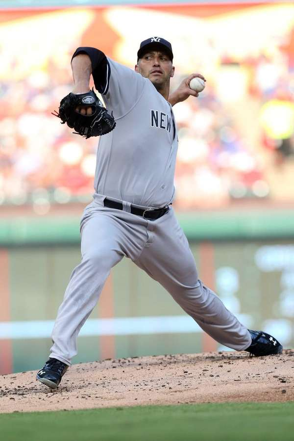 Andy Pettitte delivers a pitch against the Texas