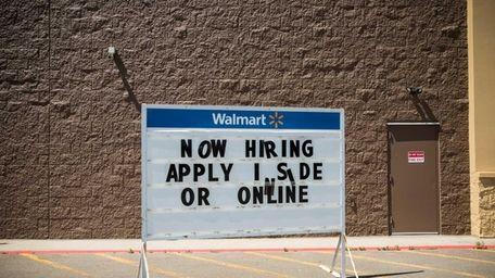 Walmart advertises job openings at a Williston, N.D.