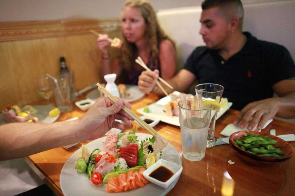 Patrons dine at Sake Asian restaurant in West