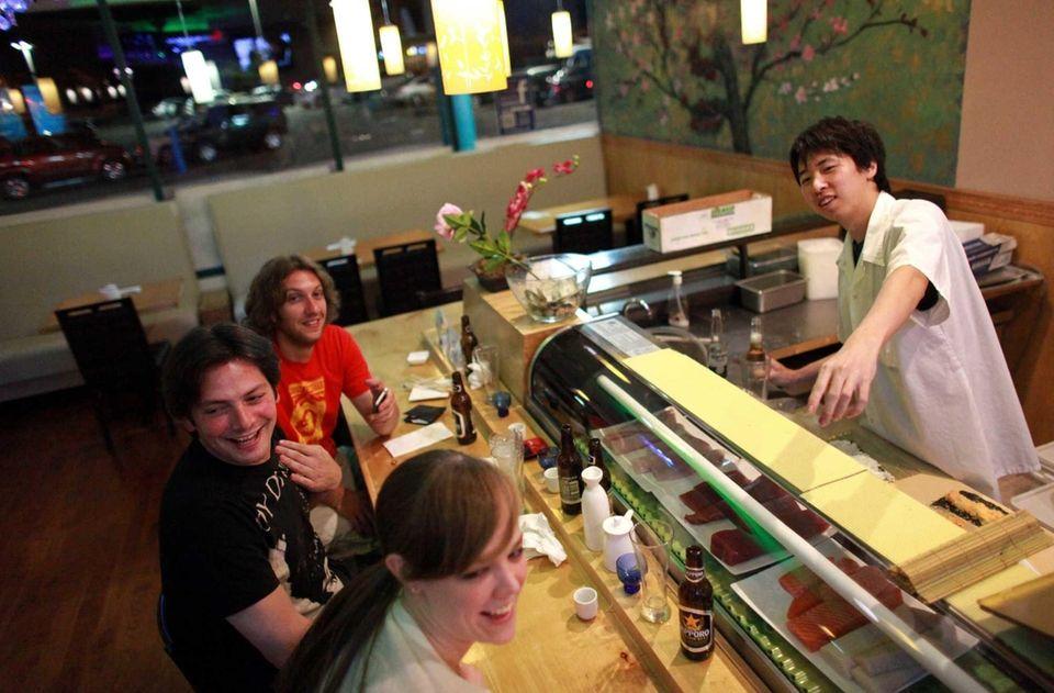 Patrons with sushi chef Kenny Liu at Sake
