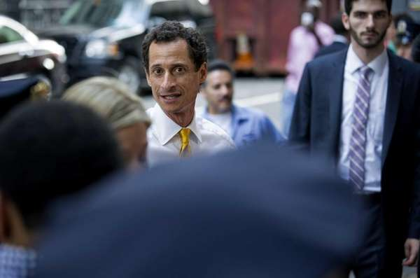 New York City mayoral candidate Anthony Weiner walks