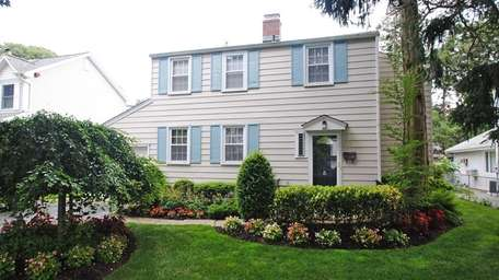 This Albertson Colonial with four bedrooms and 2½