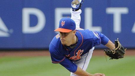 Starting pitcher Zack Wheeler of the Mets follows