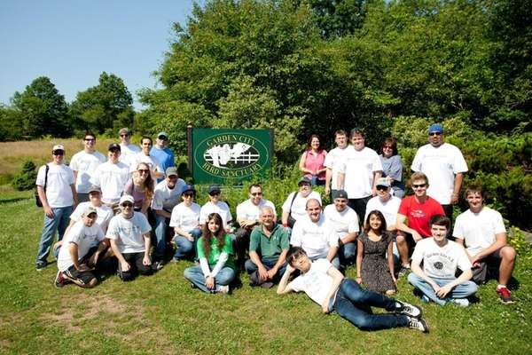 Volunteers from Liberty Mutual Insurance and Garden City