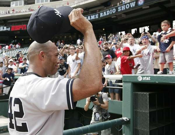Yankees relief pitcher Mariano Rivera acknowledges fans as