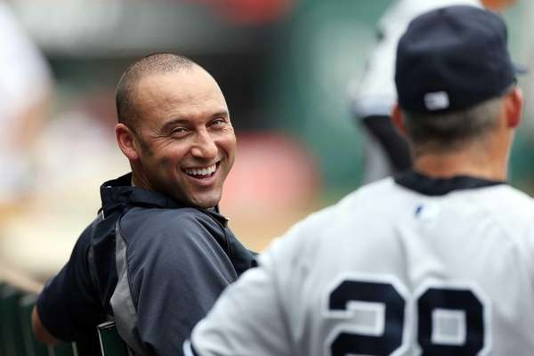 Yankees shortstop Derek Jeter, left, sits in the