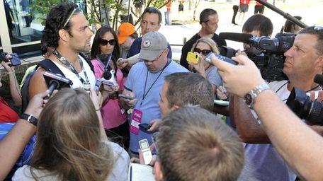 Jets quarterback Mark Sanchez talks with reporters after