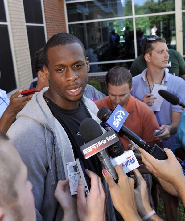 Jets quarterback Geno Smith talks with reporters after