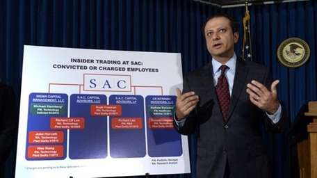 Preet Bharara speaks at a news conference about