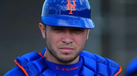 Travis_D'Arnaud looks on during a spring training workout