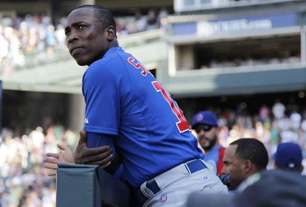 Chicago Cubs left fielder Alfonso Soriano looks on