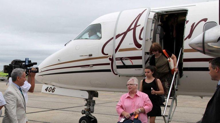 Passengers arrive from PenAir's first flight into Islip