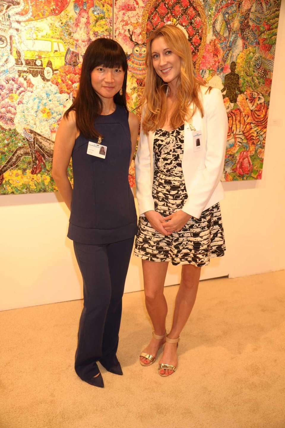 Lexing Chang and Lisa Renau attend the opening
