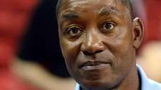 Former NBA player Isiah Thomas waits for the