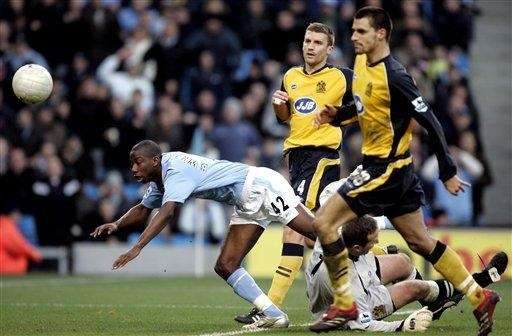 Manchester City's Bradley Wright-Phillips, left, narrowly fails to