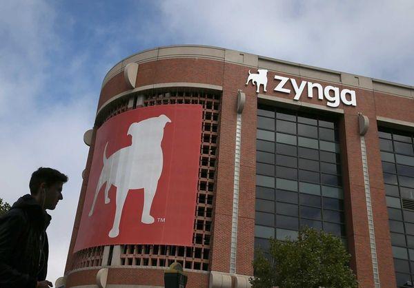 A pedestrian walks by the Zynga headquarters in