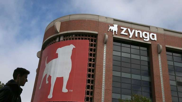 A pedestrian walks by the Zynga headquarters in