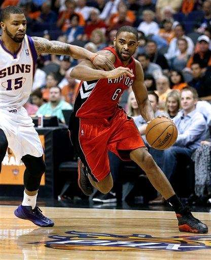 Toronto's Alan Anderson drives against Phoenix Suns' Marcus