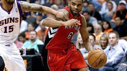 Toronto's Alan Anderson drives against Phoenix Suns' Marcus