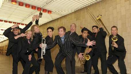 Louis Prima Jr., center, and his band performs