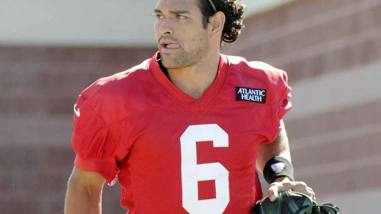 Jets quarterback Mark Sanchez watches on the first