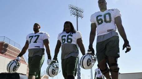 Jets players Willie Colon, left, and D'Brickashaw Ferguson,