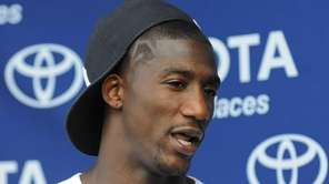 Giants safety Antrel Rolle speaks to the media