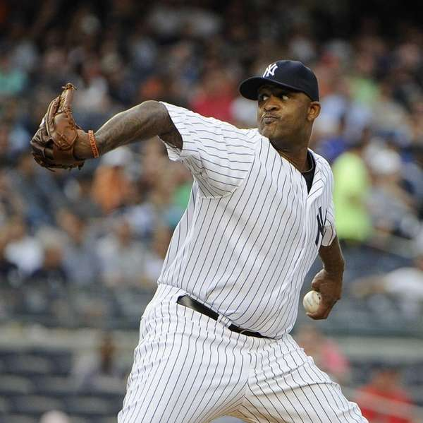 Starting pitcher CC Sabathia of the Yankees delivers