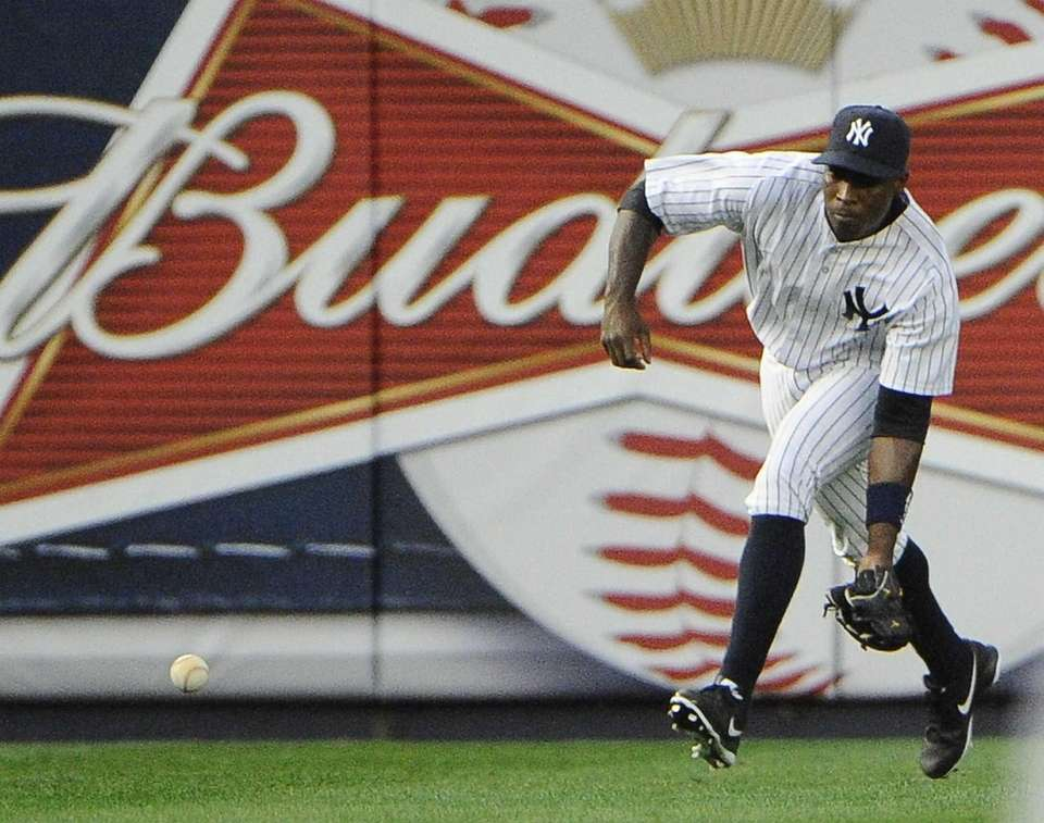Alfonso Soriano of the Yankees fields the ball