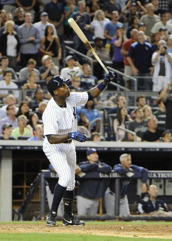 Alfonso Soriano of the Yankees flies out with