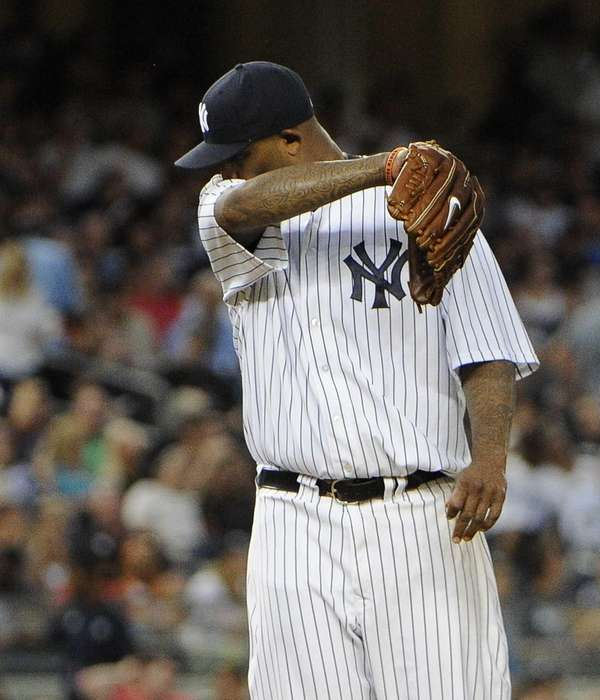 Starting pitcher CC Sabathia of the Yankees reacts