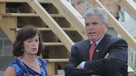 Jeanne Gargiulo stands with Suffolk County Executive Steve