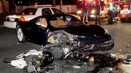 A motorcycle and a Ferrari collided at the
