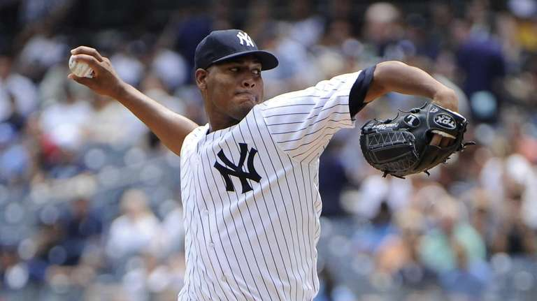 Yankees starting pitcher Ivan Nova delivers against the