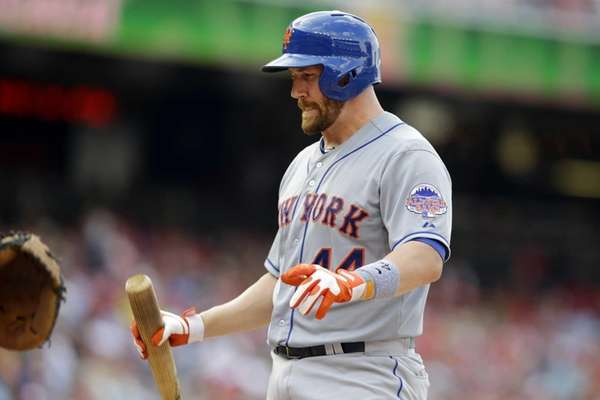 Mets' John Buck reacts after striking out during