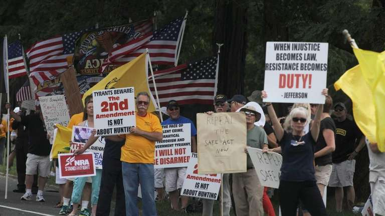 Gun Rights advocates and supporters line Veterans Memorial