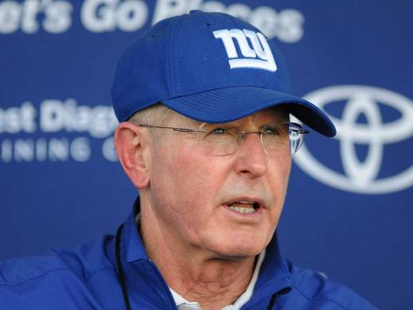 Tom Coughlin speaks to the media during training