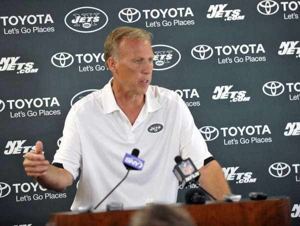 Jets general manager John Idzik talks with reporters