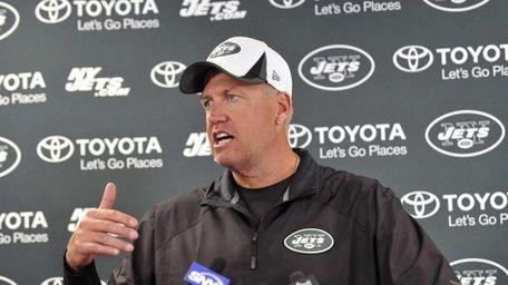 Jets head coach Rex Ryan talks with reporters