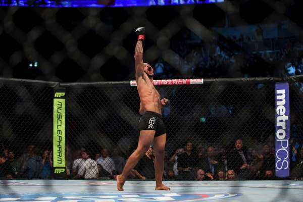 UFC flyweight champion Demetrious Johnson celebrates his victory