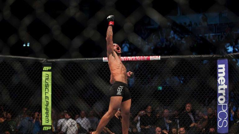 UFC flyweight champion Demetrious Johnson celebrates his victory