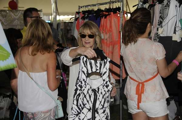 Shoppers browse the racks at Super Saturday 16,