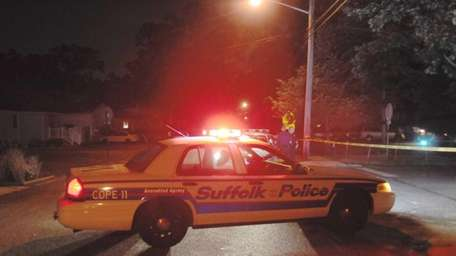 A Suffolk County police cruiser sits on Smith