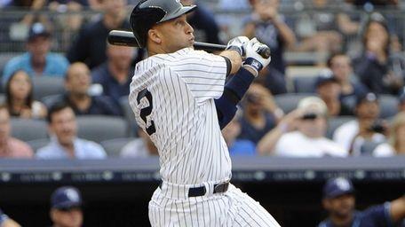 Yankees' Derek Jeter hits a home run in