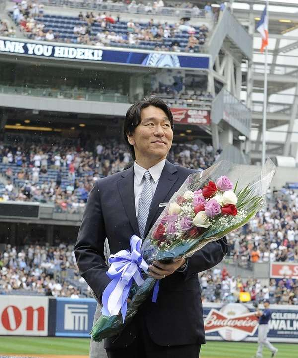 Hideki Matsui stands on the field at Yankee