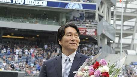 Hideki Matsui stands on the field at Yankee