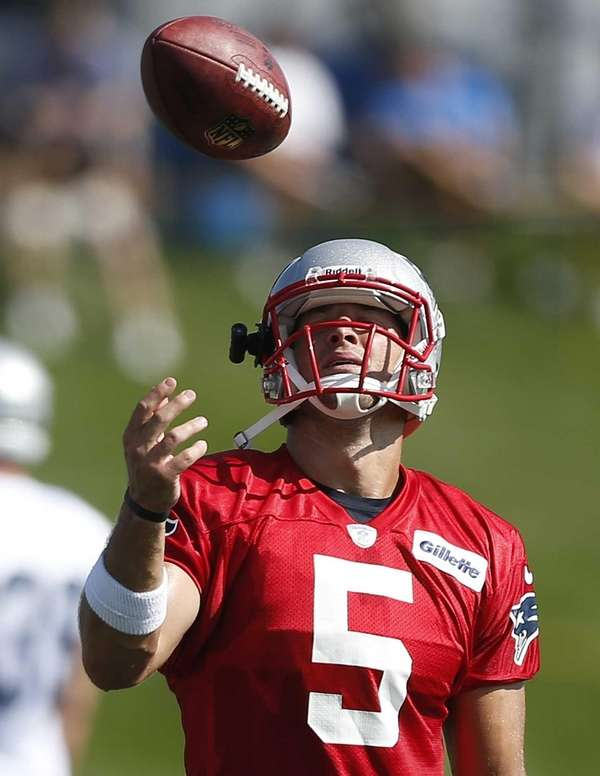 New England Patriots quarterback Tim Tebow tosses a